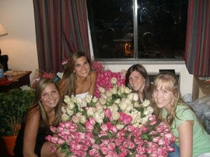 Kristi Landphere's daughters and niece posing with flowers she designed for her niece's wedding
