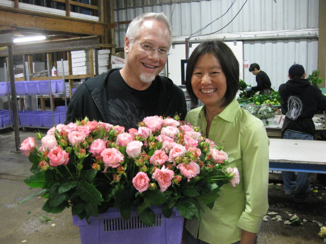 J Schwanke and Janet Louie Owner of Green Valley Floral and a Bucket of David Austin Roses
