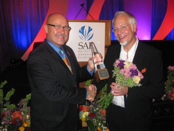PFCI Committee Chair Jerome Raska presents the Tommy Bright Award to J Schwanke