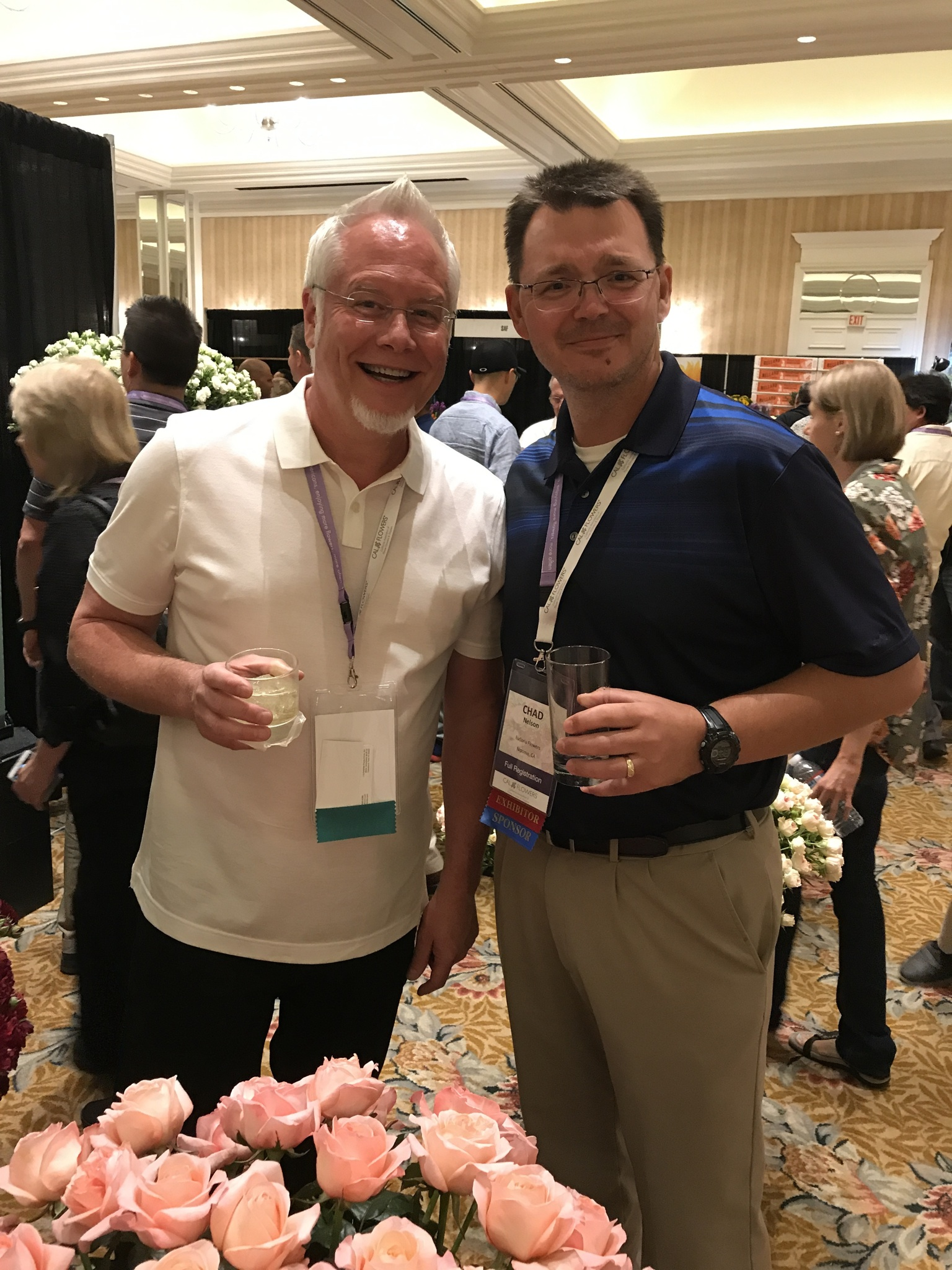 Chad from Eufloria Flowers visits with J Schwanke at the Fun N Sun Convention
