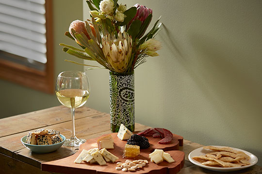 Featuring a repurposed vase from Protea Wines- with a local cheese board!