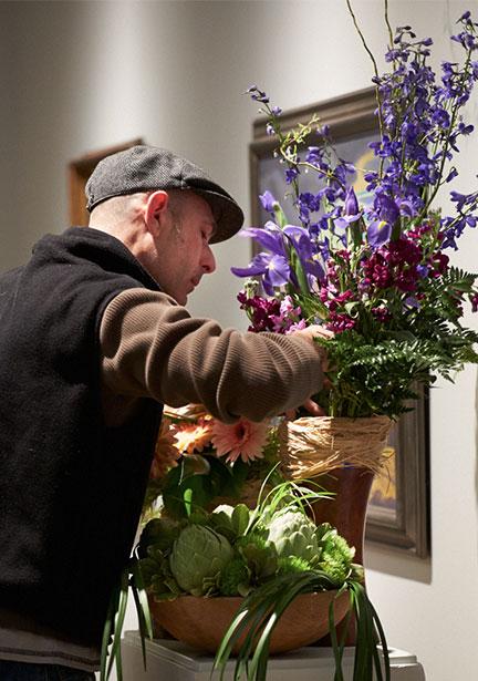 Fellow Michigan Flower Artist James Luetke making adjustments to his ART in Bloom installation.
