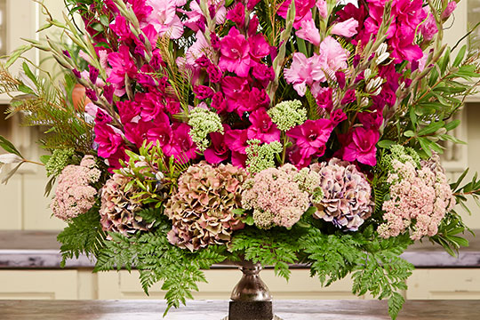 J shares the perimeter urn trick- one of his favorites for flower arranging.
