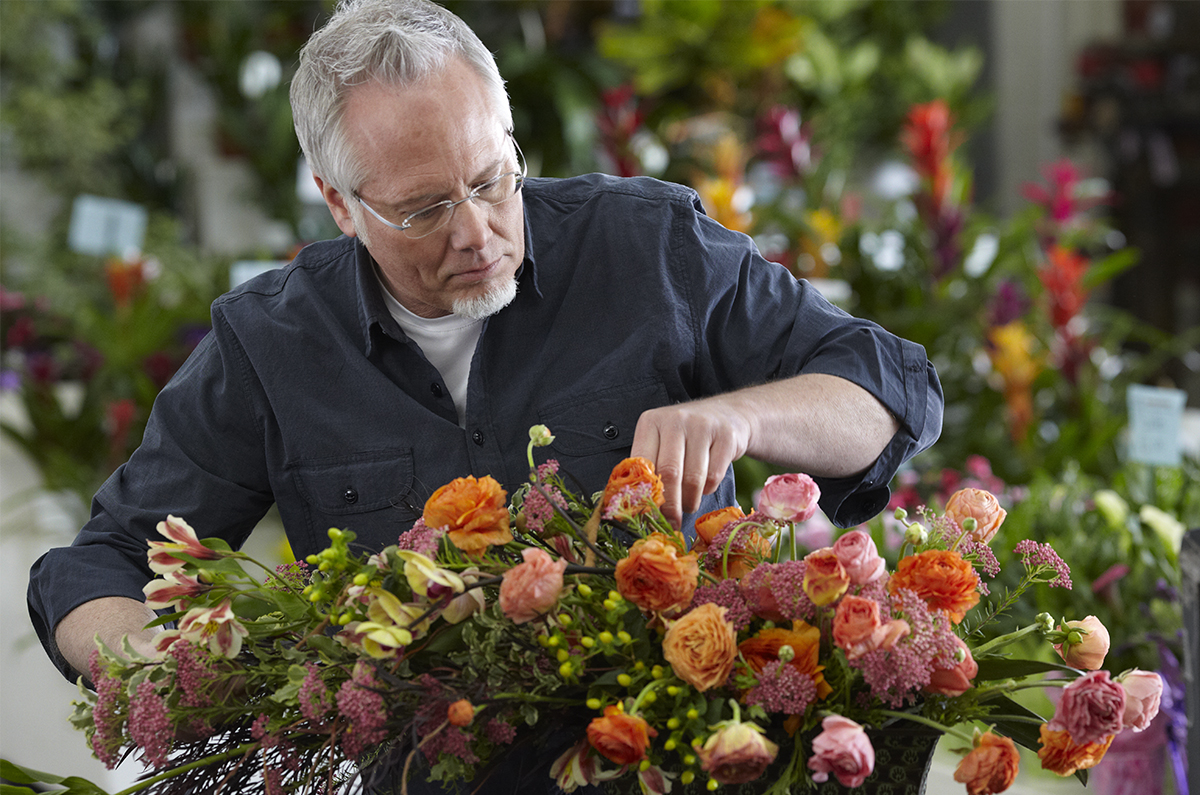 Arranging flowers at the Mellano & Co Location in the LA Flower Market!