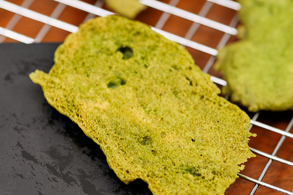 The textural back side (bottom) of the cookie is sprinkled with cookie dust - to make the moss like appearance!