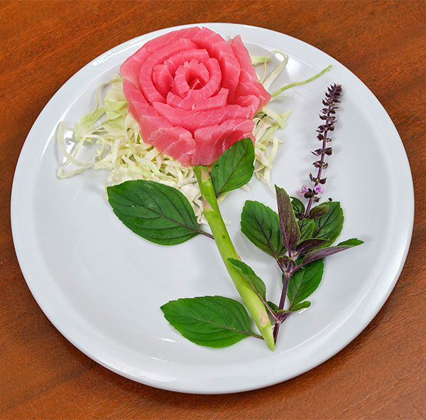 You'll learn to create an Ahi Tuna- Sashimi Rose... flowers and food meet in this delicious and beautiful entreé