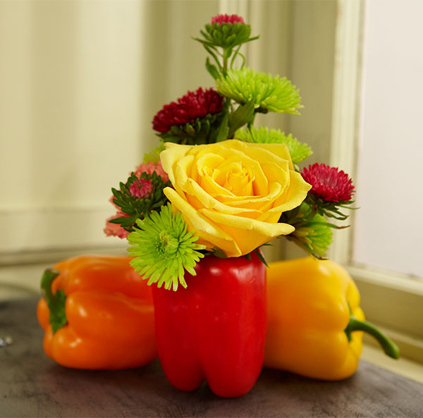 "J shows you how easy it is to create a ""VASE"" from a Pepper- and how you can add a few flowers to create a centerpiece for your next picnic!"