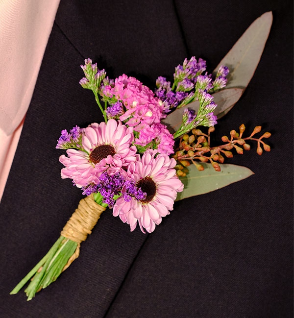 Learn to make this boutonniere and how to pin it on your lapel too!