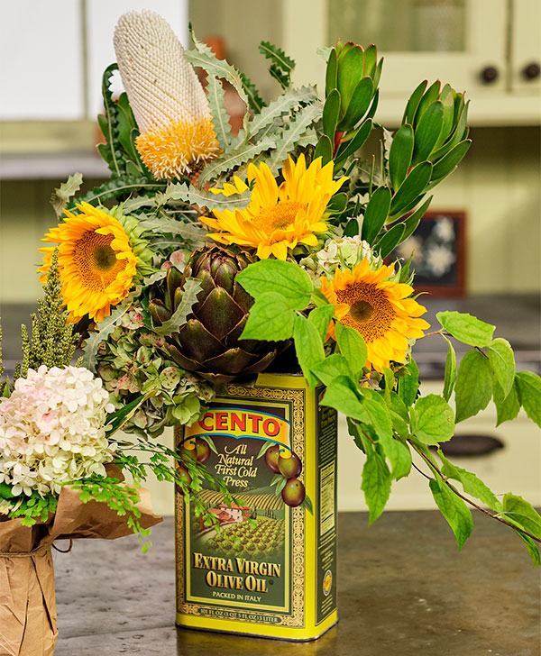Jenn single handedly- created this Arrangement of Sunflowers with Banksia Protea- in the Olive Oil tin... She's Amazing!