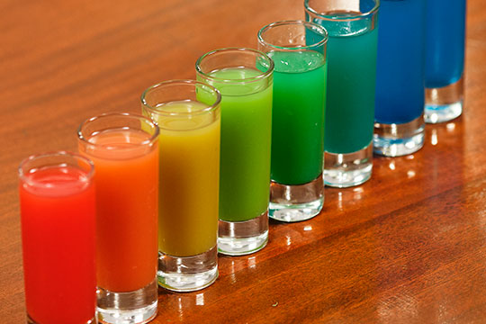 This is a fun cocktail trick- and it takes a bit of practice- but soon you'll have the Rainbow Shots pefected!