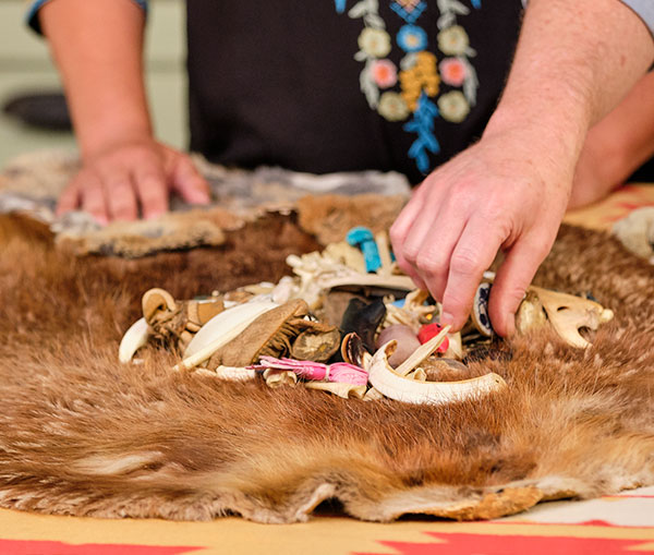 Ms. Margo- uses her sacred bones and artifacts to complete here bone readings.