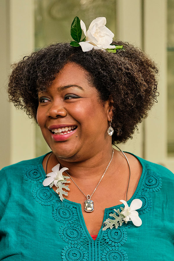 "Angela wears the Stemmed Gardenia Headband- and White Dendrobium & Dusty Miller ""necklace'..."