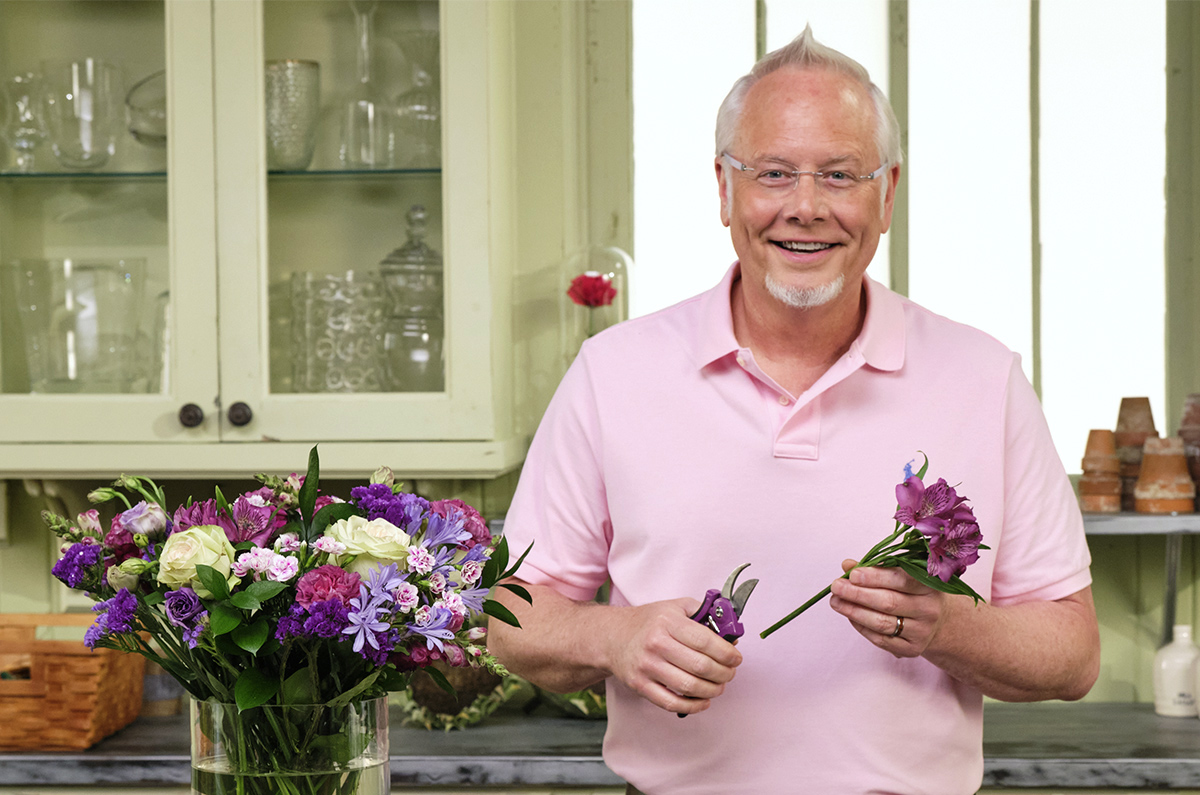 J arranging flowers with his Purple ColorPoint Bypass Pruners from Dramm Lawn and Garden Tools