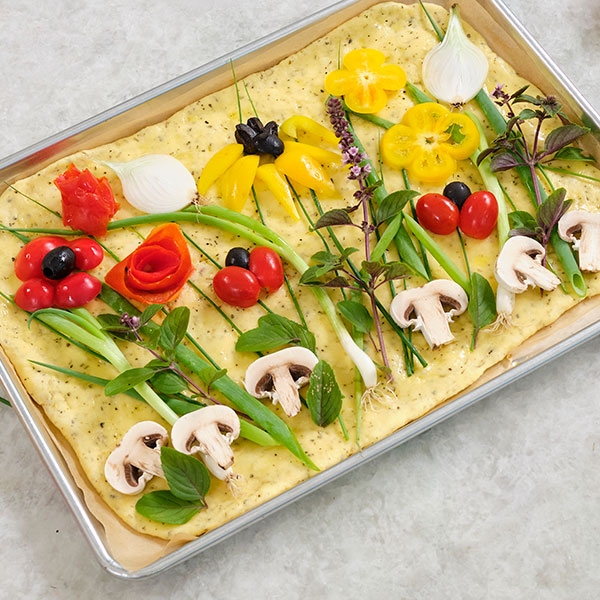 You can bring the Flower Field Vibe to your dining table with this Field of Flowers Flatbread Recipe!