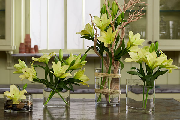 4 Different vases- with 4 different arranging tricks- will allow you spread Lilies all around the house!