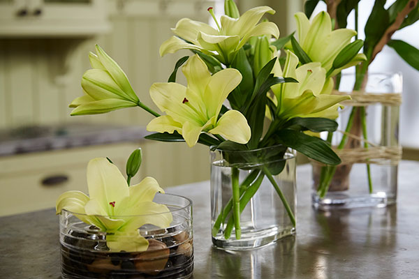 It's amazing what you can do with 10 stems of lilies (1 Bunch)- using different vases- you can spread them all around the House!