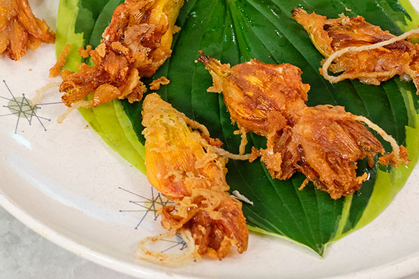 I arranged the fried Day Lily blooms on a plate with a hosta leaf- Hold on to the cotton twine- and eat it like a shrimp- hold onto the tail!