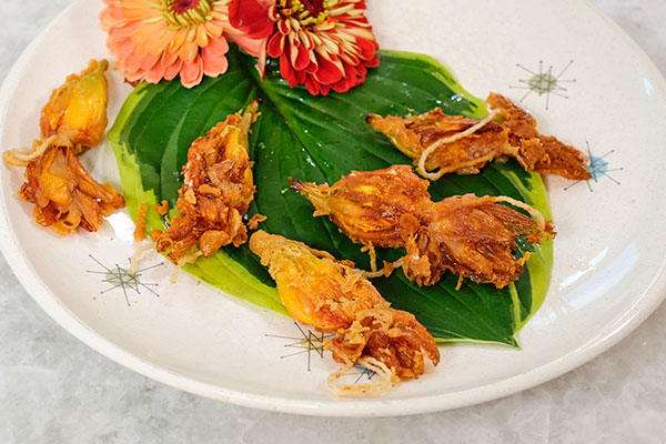 The Stuffed and Fried Day Lily Blooms are a fun treat- and it's a great way to EAT your Flowers!