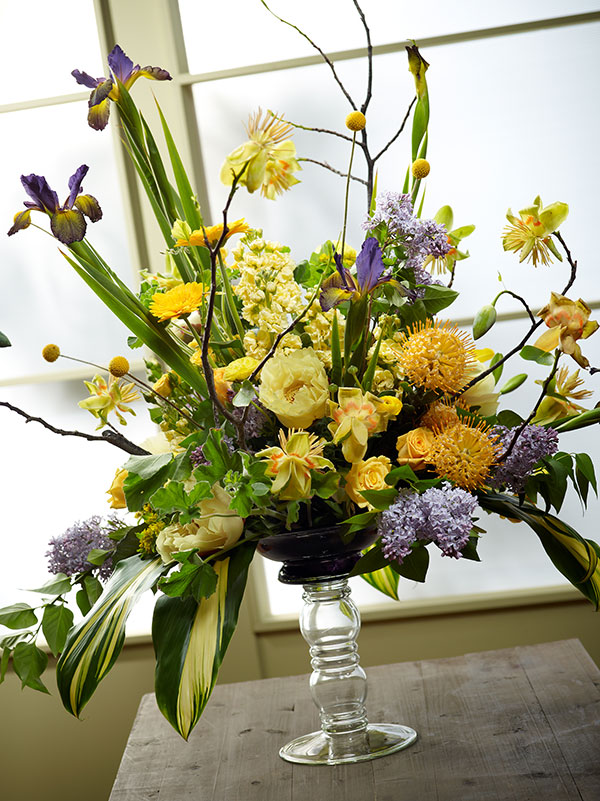 I create this beautiful arrangement- featuring purple flowers- including the popular Lilac!