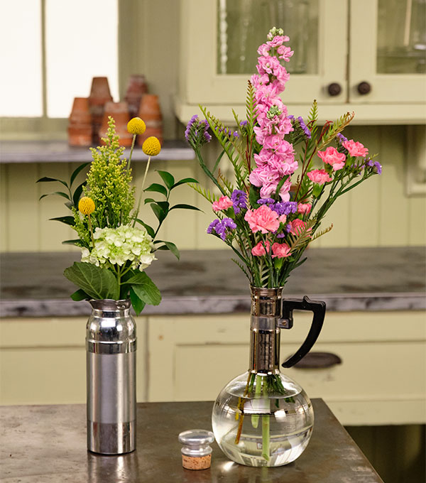 Vintage Coffee Vessels are fun to use as flower vessels- it's a great way to get your memories off the shelf!