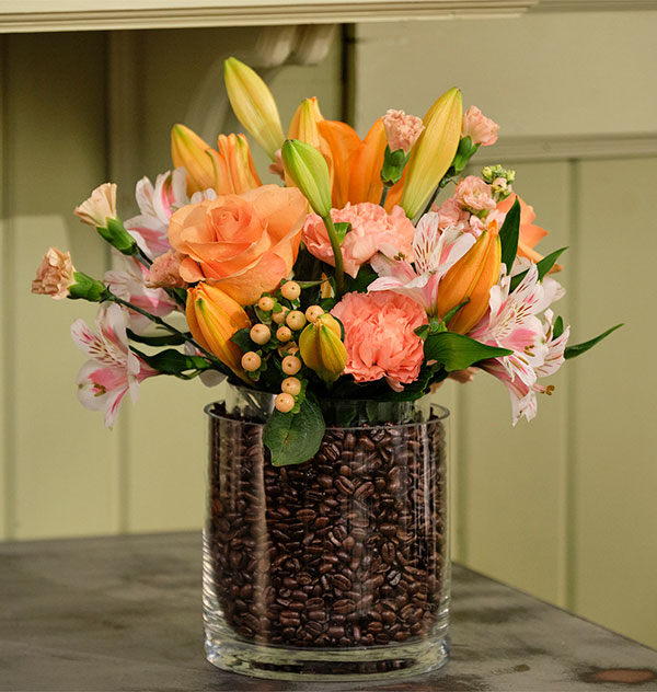 A Vase in a Vase filled with Coffee Beans- with Flowers placed gently inside... get it!