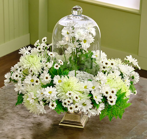 This arrangement created out of Chrysanthemums of all kinds - has a fairytale theme- Cloché Included!