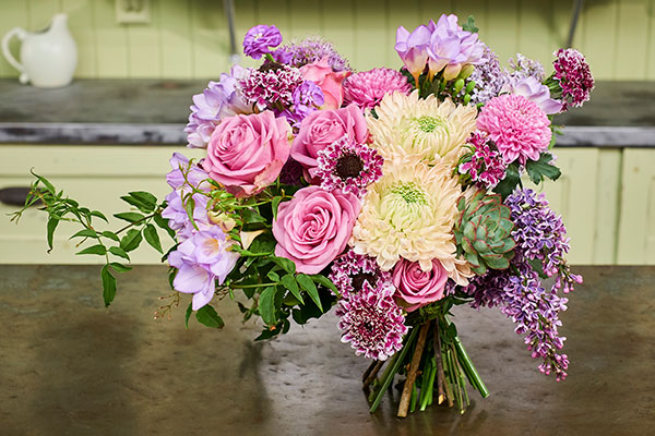 This hand tied wedding bouquet features Magnum® Chrysanthemums that have been color enhanced...