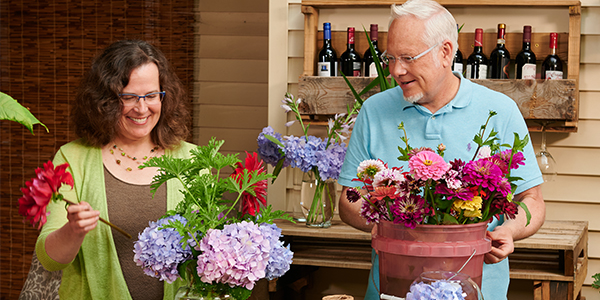 """J enjoys sharing the simple pleasure- of arranging flowers for yourself- with his guests on """"Life in Bloom""""- picture Trina Weller and J Schwanke"""