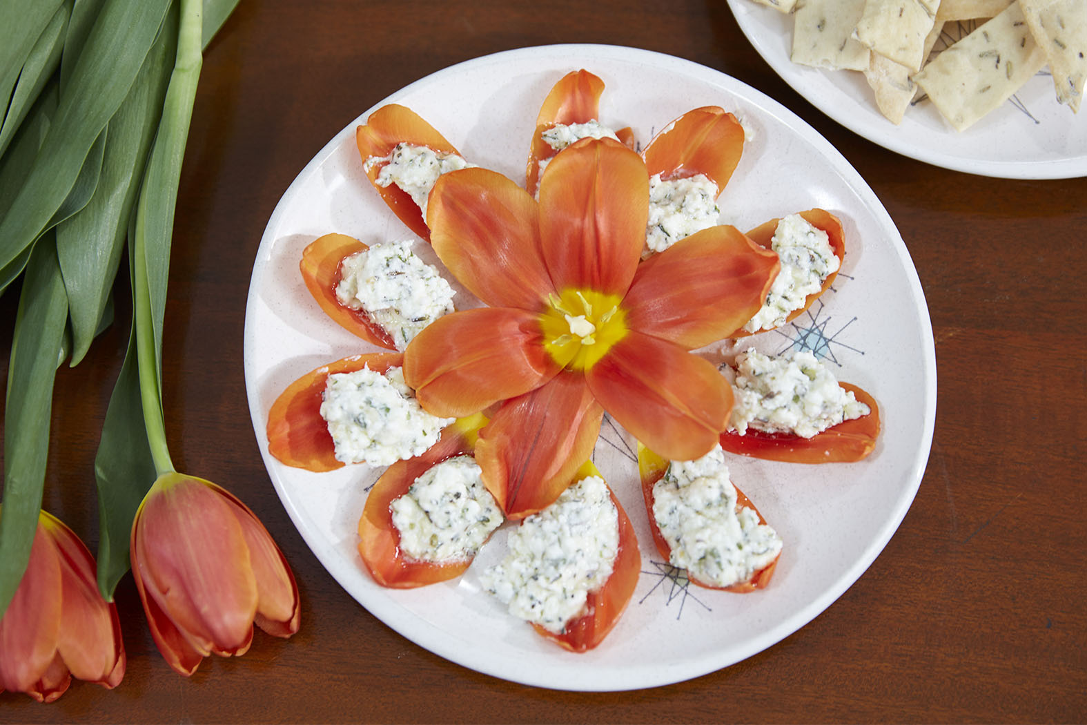 """Flower Inspired Recipes or Flower Cocktails are included each week- on """"J Schwanke's Life in Bloom"""", featured here is Herb Infused Goat Cheese served on Organic Tulip Petals."""