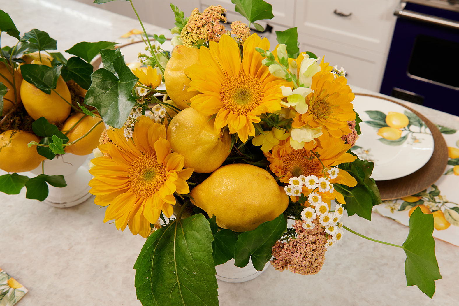 """Flower Arrangements inspired by Italy- feature Sunflowers, Fresh Lemons, Chamomile, and Cottage yarrow- to complete this inspired table setting on """"J Schwanke's Life in Bloom""""."""