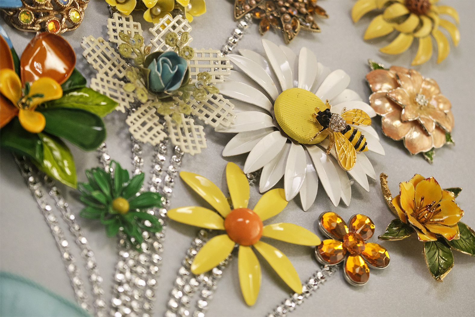 """""""J Schwanke's Life in Bloom"""" is filled with projects, recipes and crafts - all inspired by flowers- including this wall art- created from Vintage Flower Brooches- featured in Season 4- coming in April 2022."""